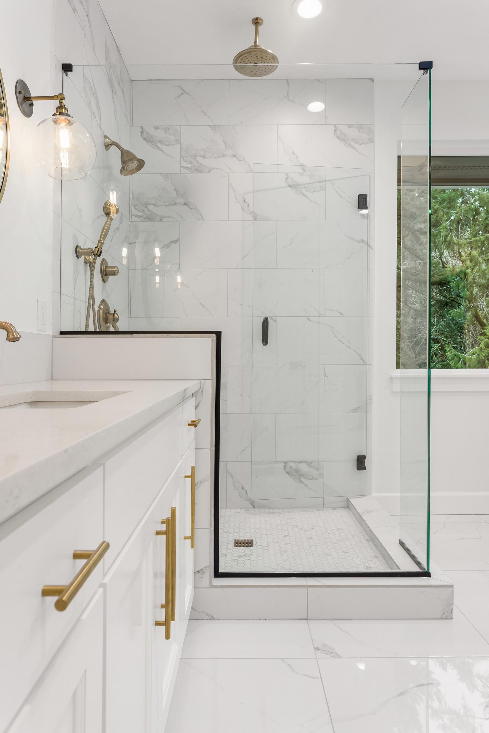 Bathroom Detail: Shower and Vanity in Ensuite Master Bathroom in New Luxury Home. Features Elegant Tile Floor